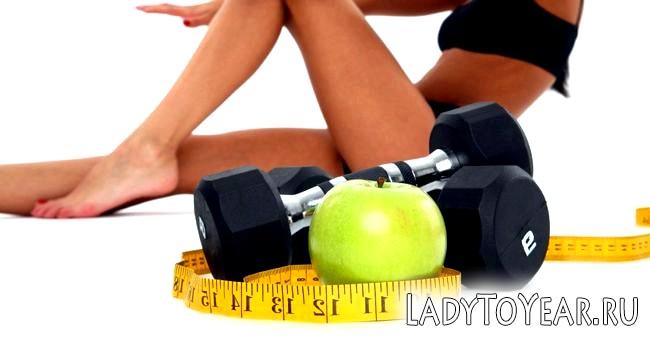 Яблуко, гантелі, вимірювальна стрічка